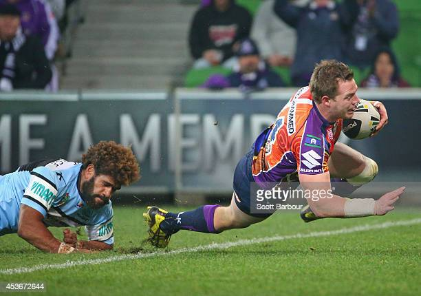 Tim Glasby of the Storm scores a try during the round 23 NRL match between the Melbourne Storm and the Cronulla Sharks at AAMI Park on August 16 2014...
