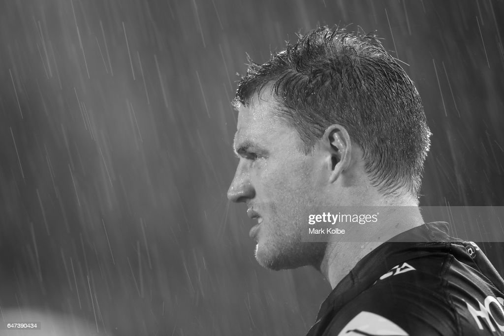Tim Glasby of the Storm watches on from the sideline in heavy rain during the round one NRL match between the Canterbury Bulldogs and the Melbourne Storm at Belmore Sports Ground on March 3, 2017 in Sydney, Australia.