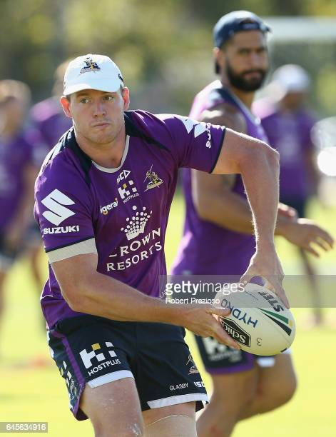 Tim Glasby prepares to offload the ball during the Melbourne Storm NRL training session at Gosch's Paddock on February 27 2017 in Melbourne Australia