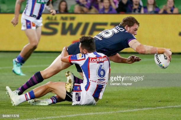 Tim Glasby scores a try during the round six NRL match between the Melbourne Storm and the Newcastle Knights at AAMI Park on April 13 2018 in...