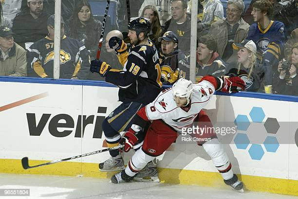 Tim Gleason of the Carolina Hurricanes collides with Tim Connolly of the Buffalo Sabres at HSBC Arena on February 5 2010 in Buffalo New York