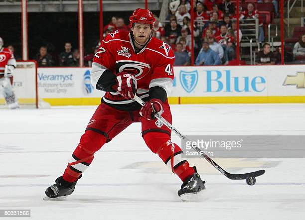 Tim Gleason of the Carolina Hurricanes skates with the puck during their NHL game against the Ottawa Senators on March 16 2008 at RBC Center in...