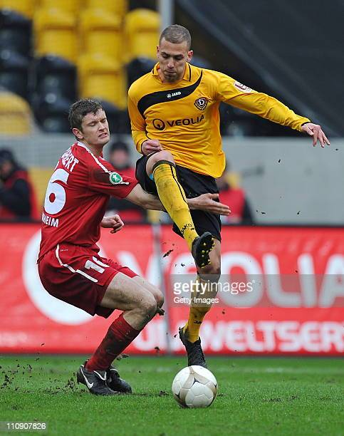Tim Goehlert of Heidenheim challenges Dani Schahin of Dresden during the Third League match between Dynamo Dresden and 1. FC Heidenheim at the Rudolf...
