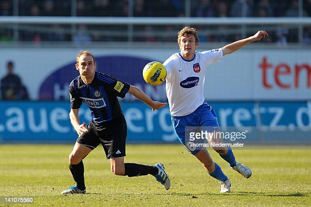 Tim Goehlert of Heidenheim fights for the ball with Robert Lechleiter of Aalen during the Third League match between 1FC Heidenheim and VfR Aalen at...