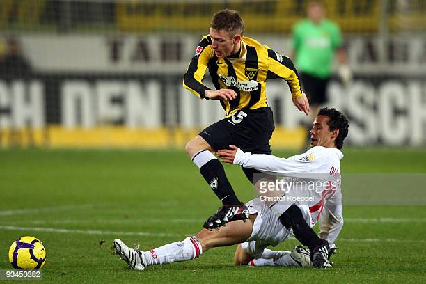 Tim Gorschlueter of Ahlen tackles Manuel Junglas of Aachen during the second Bundesliga match between Alemannia Aachen and Rot Weiss Ahlen at the...