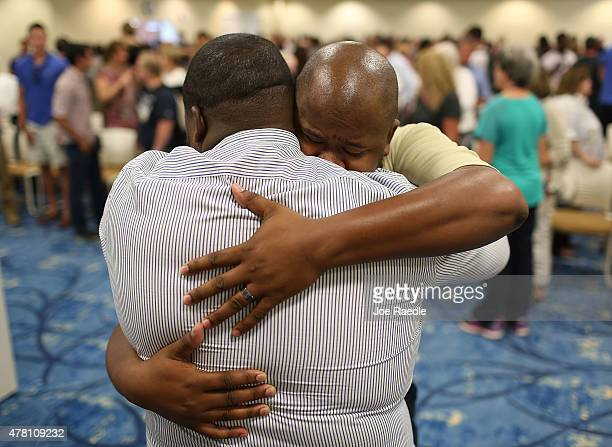 Tim Grant is comforted during a prayer vigil at the Charleston Southern University for the victims of the Emanuel African Methodist Episcopal Church...