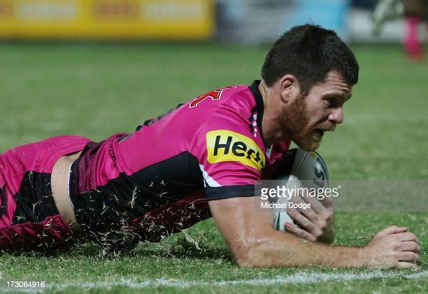 Tim Grant of the Panthers scores a try during the round 17 NRL match between the Gold Coast Titans and the Penrith Panthers at TIO Stadium on July 6,...