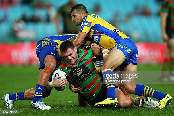 Tim Grant of the Rabbitohs is tackled during the round 11 NRL match between the South Sydney Rabbitohs and the Parramatta Eels at ANZ Stadium on May...