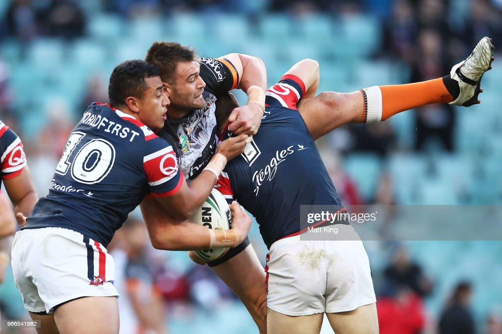 Tim Grant of the Tigers is tackled during the round 13 NRL match between the Sydney Roosters and the Wests Tigers at Allianz Stadium on June 3, 2018 in Sydney, Australia.