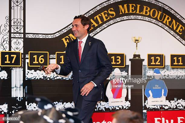 Tim Gredley draws a number for Big Orange during the Melbourne Cup Barrier Draw at Flemington Racecourse on October 29 2016 in Melbourne Australia