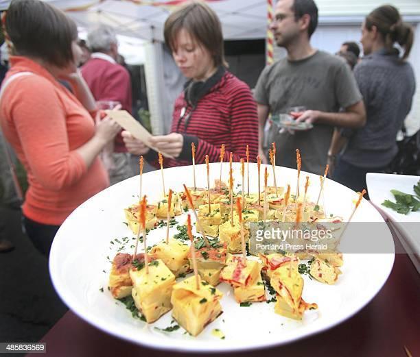 Tim Greenway Amy Clearwater of Portland left and Caitlyn Horose of Portland read the Bazkari menu featuring the pintxos de tortilla Espanola a...
