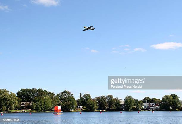 A bombardier drops a pumpkin out of a plane over Pond during the Operation Pumpkin Drop in Sanford during Harvest Daze on September 20 2008