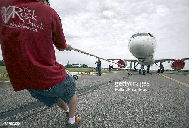 Tim Greenway/Staff photographer A member of The Rock Church in South Portland pulls a Boeing 757 weighing over 200000 pounds during Portland...