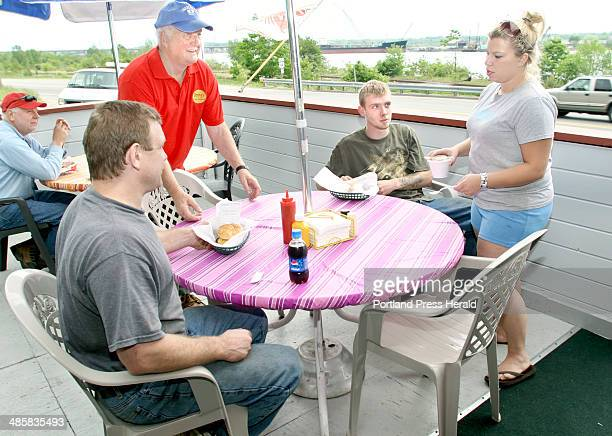 Benny's owner Ben Sawyer and Benny's manager Kim Morrison serves Dave Dibiase and his son Nick their haddock sandwiches at Benny's on 199 West...