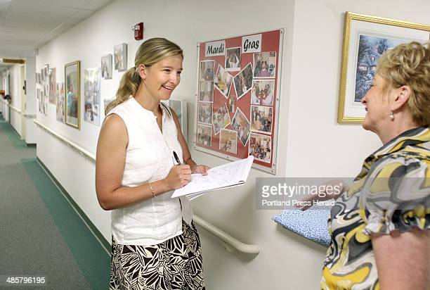 Lynn Peel senior care consultant of Beach Glass Transitions left takes down notes while on a tour of the Falmouth House at OceanView at Falmouth with...