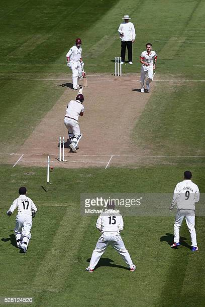 Tim Groenewald of Somerset is bowled by Kyle Jarvis of Lancashire during day four of the Specsavers County Championship Division One match between...