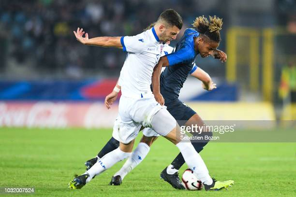 Tim Hall of Luxembourg and Christopher Nkunku of France during the qualifying European U21 match between France and Luxembourg on September 11 2018...