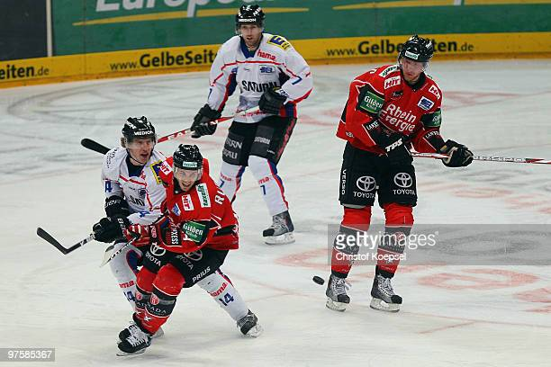Tim Hambly of Ingolstadt tackles Daniel Rudslaett of Koelner Haie during the DEL match between Koelner Haie and ERC Ingolstadt at the Lanxess Arena...