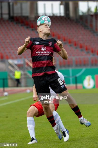 Tim Handwerker of 1FC Nuernberg and Lukas Klostermann of RB Leipzig during the DFB Cup first round match between 1 FC Nuernberg and RB Leipzig at...