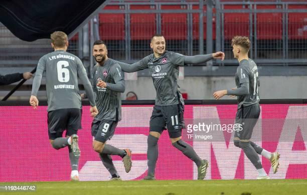 Tim Handwerker of 1.FC Nuernberg, Mikael Ishak of 1.FC Nuernberg, Adam Zrelak of 1.FC Nuernberg and Robin Hack of 1.FC Nuernberg celebrate during a...