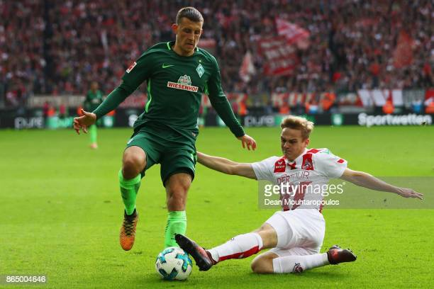 Tim Handwerker of FC Koeln tackles Maximilian Eggestein of Werder Bremen during the Bundesliga match between 1. FC Koeln and SV Werder Bremen held at...