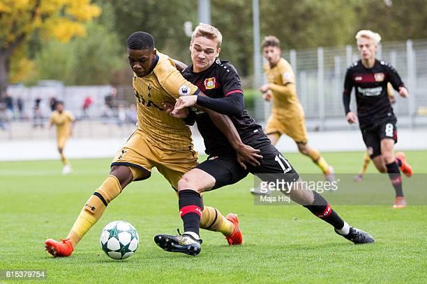 Tim Handwerker of Leverkusen battles for the ball with Japhet Tanganga of Tottenham during the UEFA Youth Champions League match between Bayer...