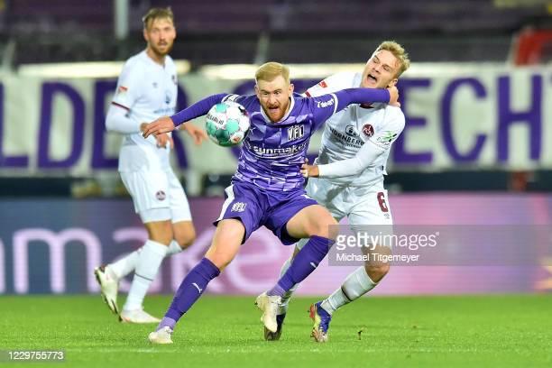 Tim Handwerker of Nuernberg and Sebastian Kerk of Osnabrueck fight for the ball during the Second Bundesliga match between VfL Osnabrück and 1. FC...