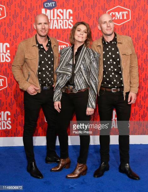 Tim Hanseroth Brandi Carlisle and Phil Hanseroth attend the 2019 CMT Music Awards at the Bridgestone Arena in Nashville Tennessee