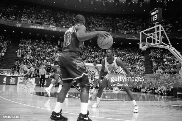 Tim Hardaway dribbles against Joe Dumars during the 1992 NBA AllStar Game at Orlando Arena on February 9 1992 in Orlando Florida NOTE TO USER User...