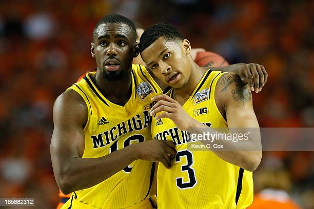 Tim Hardaway Jr #10 and Trey Burke of the Michigan Wolverines react in the second half against the Syracuse Orange during the 2013 NCAA Men's Final...