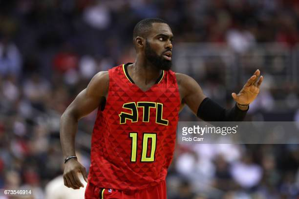 Tim Hardaway Jr #10 of the Atlanta Hawks celebrates after scoring against the Washington Wizards in the first half of Game Five of the Eastern...