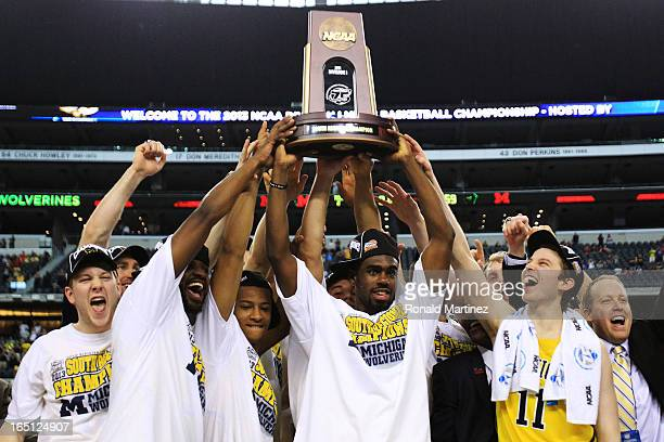Tim Hardaway Jr #10 of the Michigan Wolverines and teammate celebrate their 79 to 59 win ovewr the Florida Gators during the South Regional Round...
