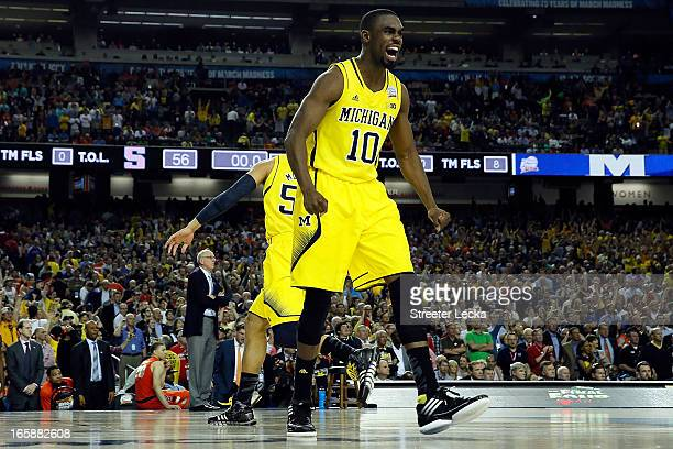 Tim Hardaway Jr #10 of the Michigan Wolverines celebrates after they won 6156 against the Syracuse Orange during the 2013 NCAA Men's Final Four...