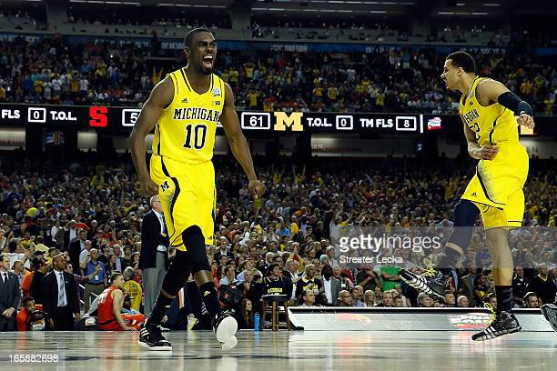 Tim Hardaway Jr #10 of the Michigan Wolverines celebrates the Wolverines 6156 victory against the Syracuse Orange during the 2013 NCAA Men's Final...