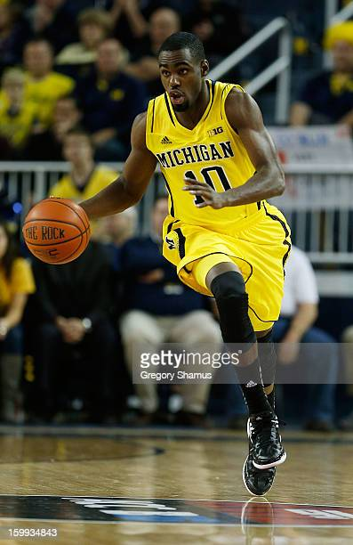 Tim Hardaway Jr #10 of the Michigan Wolverines dribbles down the court while playing the North Carolina State Wolfpack at Crisler Center on November...