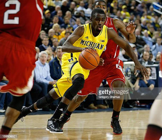 Tim Hardaway Jr #10 of the Michigan Wolverines drives to the basket while playing the North Carolina State Wolfpack at Crisler Center on November 27...
