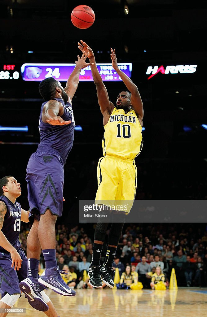 Tim Hardaway Jr. #10 of the Michigan Wolverines hits a basket over the reach of Thomas Gipson #42 of the Kansas State Wildcats at Madison Square Garden on November 23, 2012 in New York City. Michigan Wolverines defeated Kansas State Wildcats 71-57.
