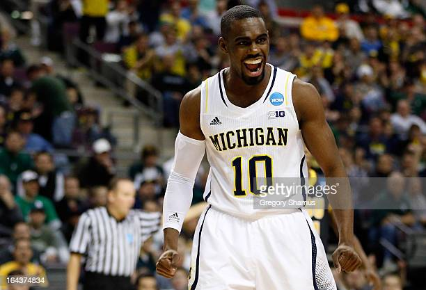Tim Hardaway Jr #10 of the Michigan Wolverines reacts in the first half against the Virginia Commonwealth Rams during the third round of the 2013...