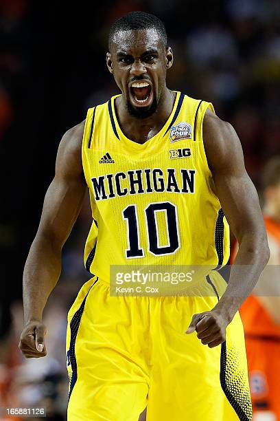 Tim Hardaway Jr #10 of the Michigan Wolverines reacts in the first half against the Syracuse Orange during the 2013 NCAA Men's Final Four Semifinal...