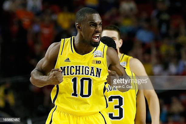 Tim Hardaway Jr #10 of the Michigan Wolverines reacts in the second half against the Syracuse Orange during the 2013 NCAA Men's Final Four Semifinal...