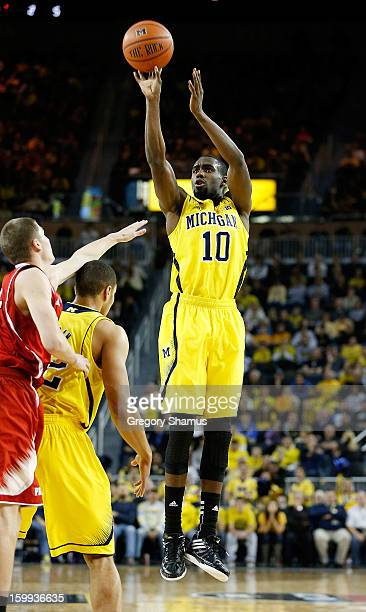 Tim Hardaway Jr #10 of the Michigan Wolverines takes a shot while playing the North Carolina State Wolfpack at Crisler Center on November 27 2012 in...