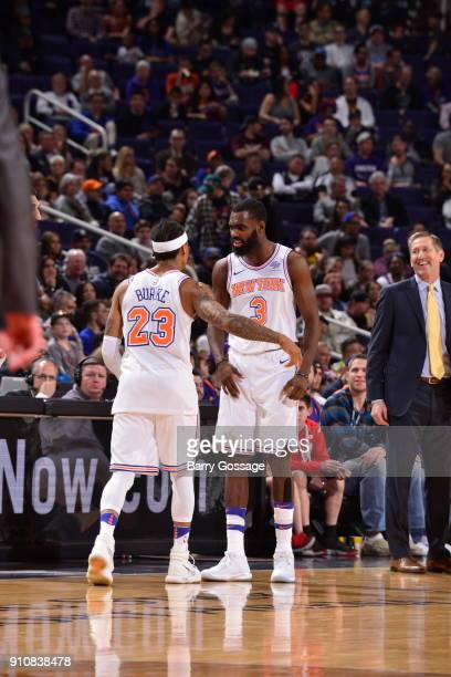 Tim Hardaway Jr #3 celebrates with Trey Burke of the New York Knicks during the game against the Phoenix Suns on January 26 2018 at Talking Stick...