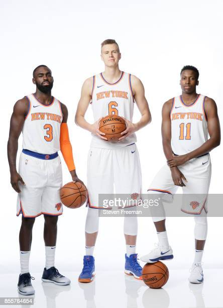 Tim Hardaway Jr #3 Kristaps Porzingis and Frank Ntilikina of the New York Knicks pose for a portrait during Media Day on September 25 2017 at the...