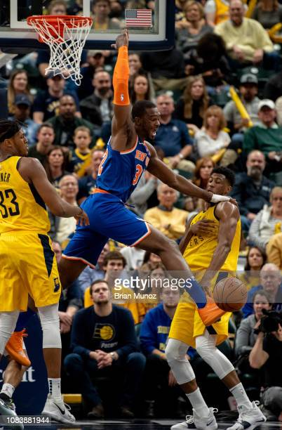 Tim Hardaway Jr #3 of the New York Knicks blocks a shot made by Aaron Holiday of the Indiana Pacers during a game at Bankers Life Fieldhouse on...