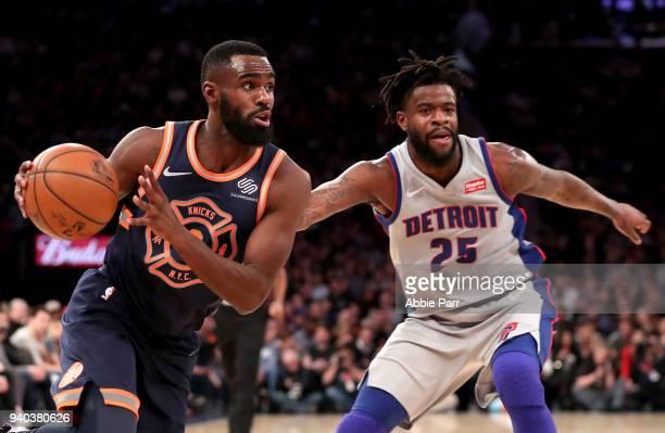 Tim Hardaway Jr #3 of the New York Knicks dribbles towards the basket against Reggie Bullock of the Detroit Pistons in the third quarter during their...
