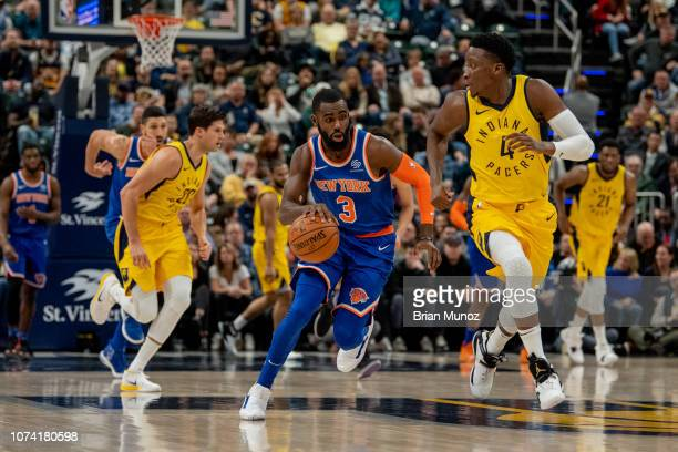 Tim Hardaway Jr #3 of the New York Knicks drives the ball up the court during the first half of the game against the Indiana Pacers at Bankers Life...