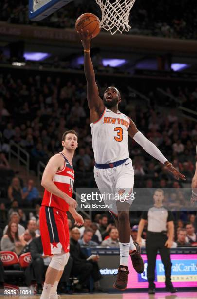 Tim Hardaway Jr #3 of the New York Knicks lays up a shot in a preseason NBA basketball game against the Washington Wizards on October 13 2017 at...