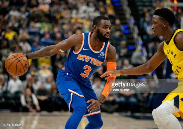 Tim Hardaway Jr #3 of the New York Knicks looks to pass the ball away from Cory Joseph of the Indiana Pacers during the first half of the game at...