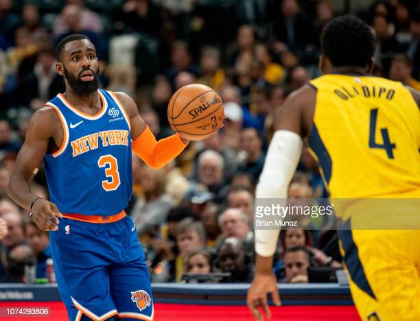 Tim Hardaway Jr #3 of the New York Knicks looks to pass the ball away from Victor Oladipo of the Indiana Pacers during the first half of the game at...