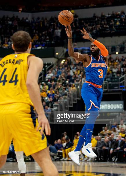 Tim Hardaway Jr #3 of the New York Knicks shoots a three point basket during the first period of the game against the Indiana Pacers at Bankers Life...